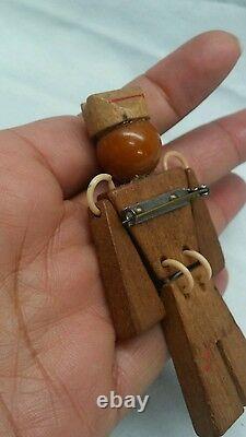 Beautiful vintage carve bakelite wood soldier pin brooch