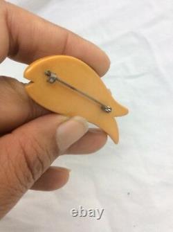 Stunning vintage Carved Egg Yolk Butterscotch Bakelite Fish pin brooch