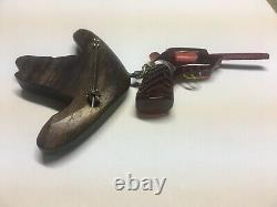 UNUSUAL Bakelite Tortoise Gun w Metal Trigger on Carved Wood Hat Pin Vintage