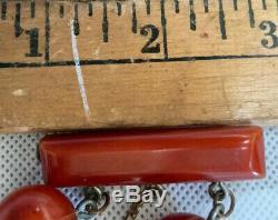 VINTAGE BAKELITE PIN BROOCH 3 DANGLING AMBER BASKETBALLS, SOCCER BALLS 1 7/8 l