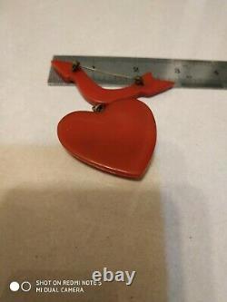 Very rare vintage bakelite dangle arrow to heart pin crooch