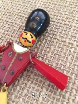 Vintage BAKELITE jointed british soldier man pin