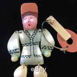 Vintage Bakelite Celluloid Plastic Pin Dancing Man With Guitar