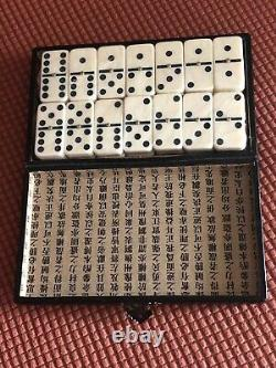 Vintage Chinese dominoes game ivory or Bakelite with brass pin points
