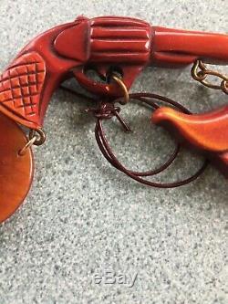 Vintage Western style Bakelite Brooch pin Gun, Saddle, Hat and rope 1930s 1940s